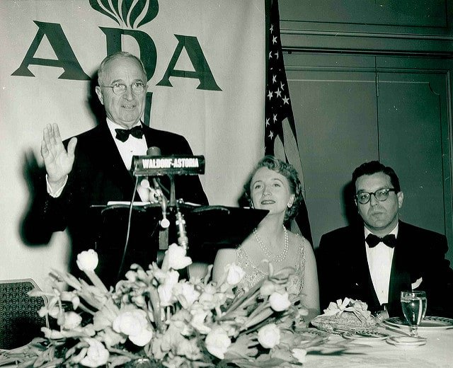ADA History: President Truman speaking in front of an ADA banner.